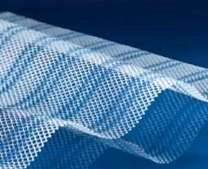 Partly absorbable mesh for hernia surgery